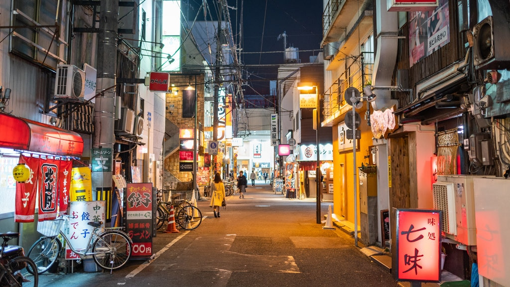 Matsuyama showing night scenes and a city