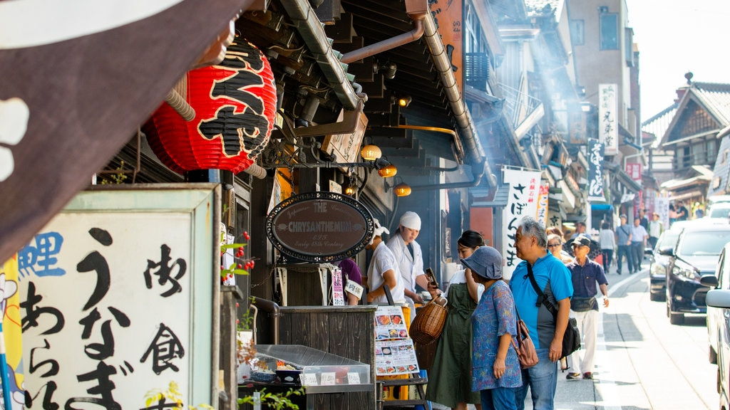 Narita Omotesando featuring street scenes, markets and signage