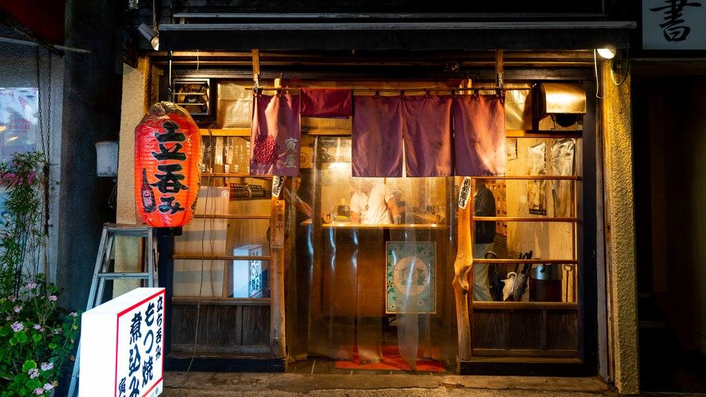 Narita featuring signage and night scenes