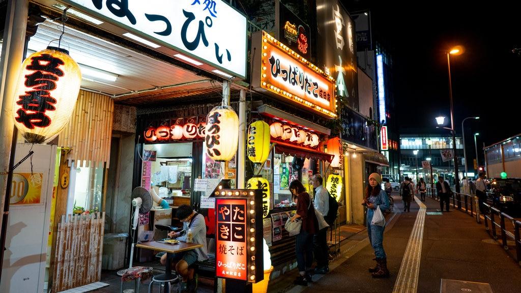 Narita featuring signage, street scenes and night scenes