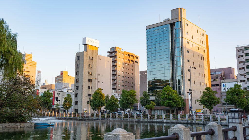 Matsuyama which includes a sunset, a city and a pond