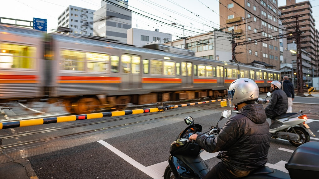 Matsuyama showing motorcycle riding and railway items