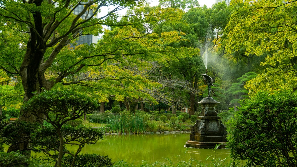 Hibiya Park which includes a pond