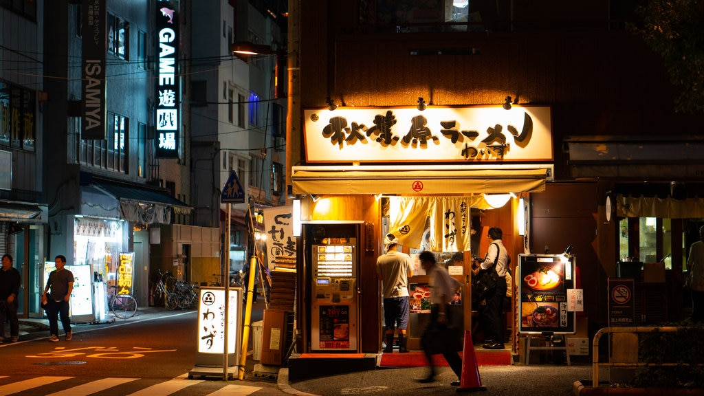 Chiyoda which includes signage, street scenes and night scenes