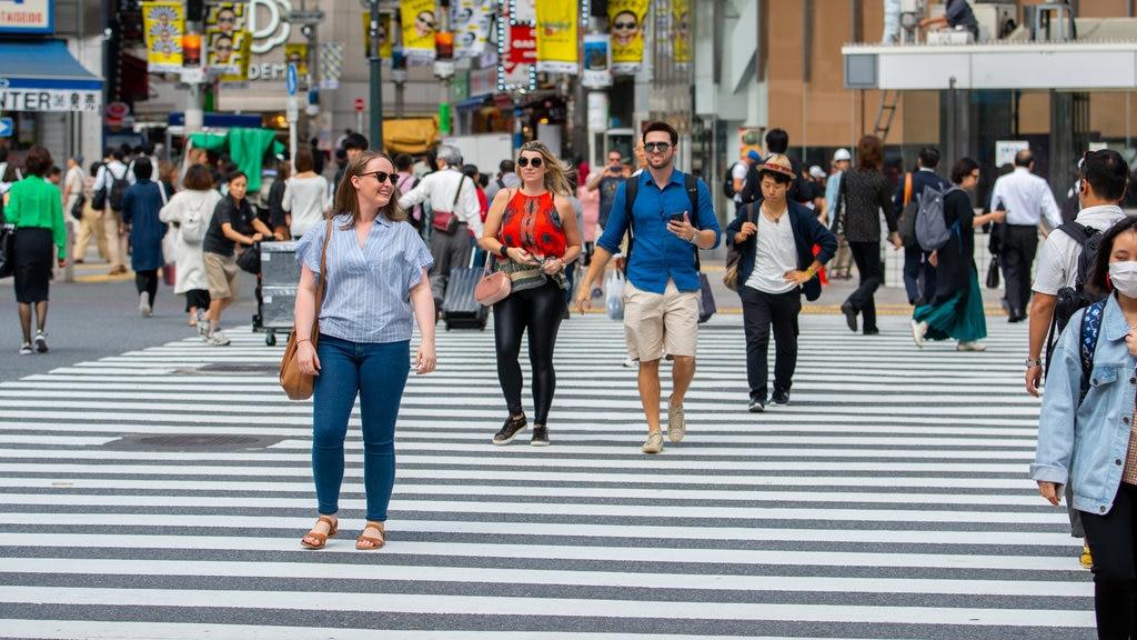 Shibuya which includes street scenes