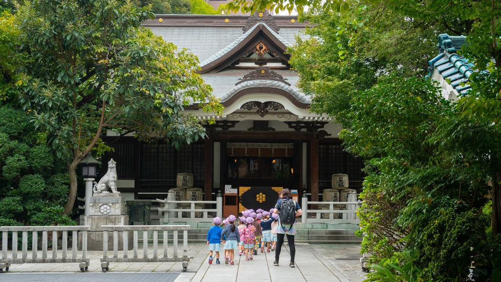 Torigoe Shrine which includes heritage elements as well as a small group of people