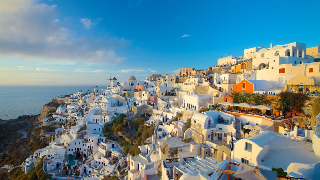 Cyclades Islands which includes a sunset, a small town or village and a coastal town