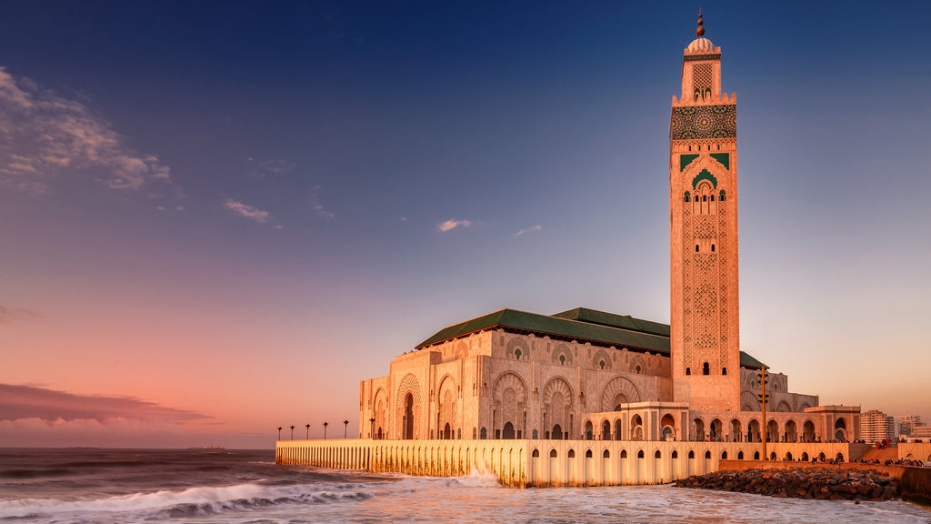 Hassan II Mosque showing general coastal views, heritage architecture and a sunset