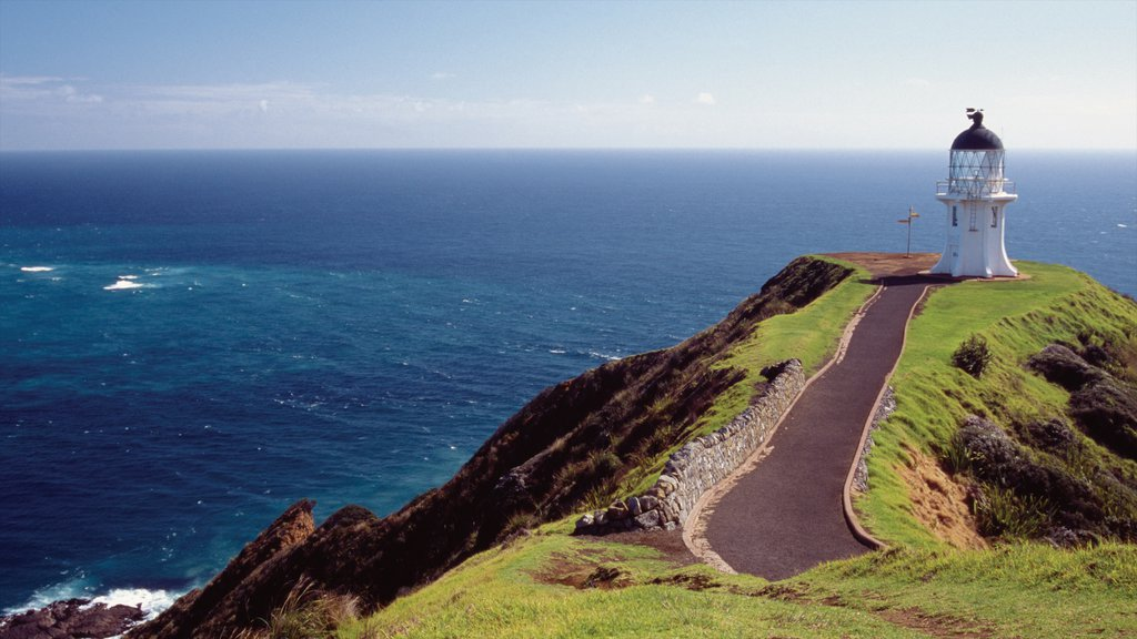 Cape Reinga Lighthouse featuring rocky coastline and a lighthouse