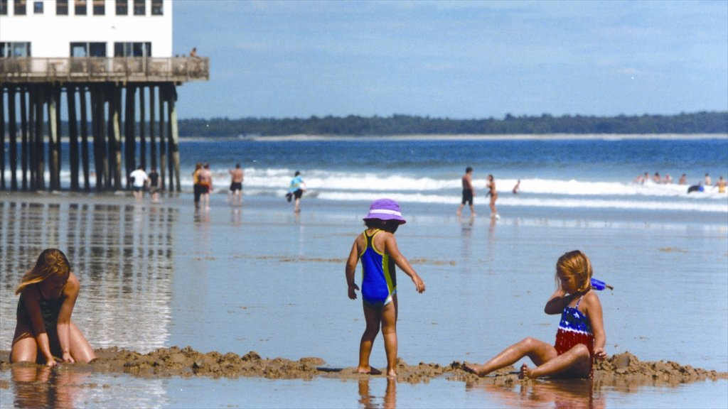 Old Orchard Beach which includes a beach and a coastal town as well as children