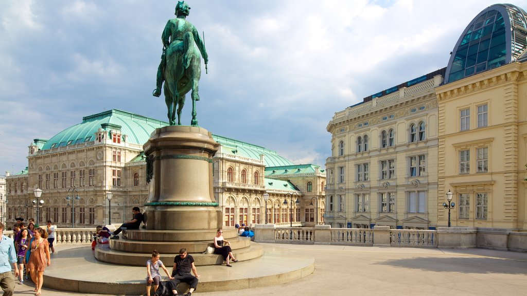 Albertina which includes a statue or sculpture, a city and a square or plaza