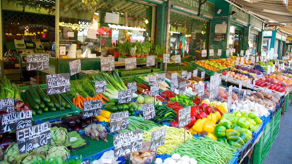 Naschmarkt que incluye señalización, mercados y comida