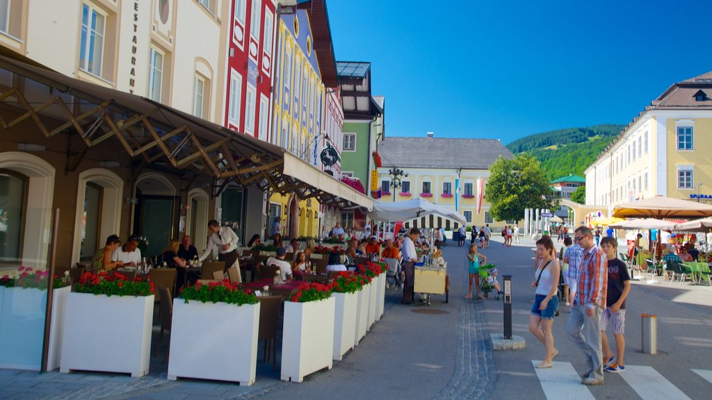 Mondsee which includes street scenes, outdoor eating and a small town or village