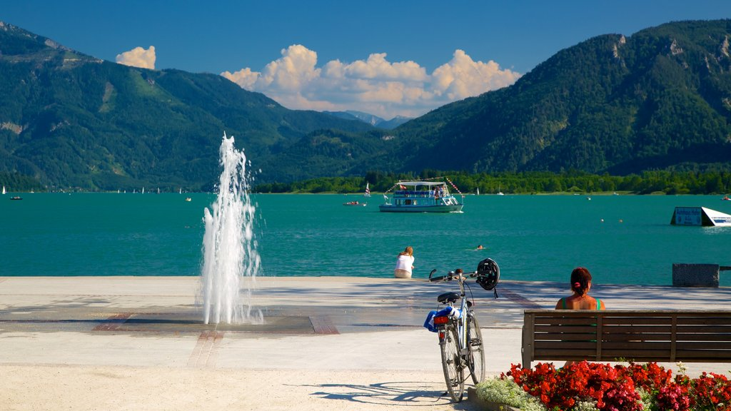 Mondsee featuring mountains, a fountain and a lake or waterhole