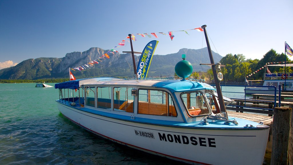 Mondsee showing a lake or waterhole, signage and boating