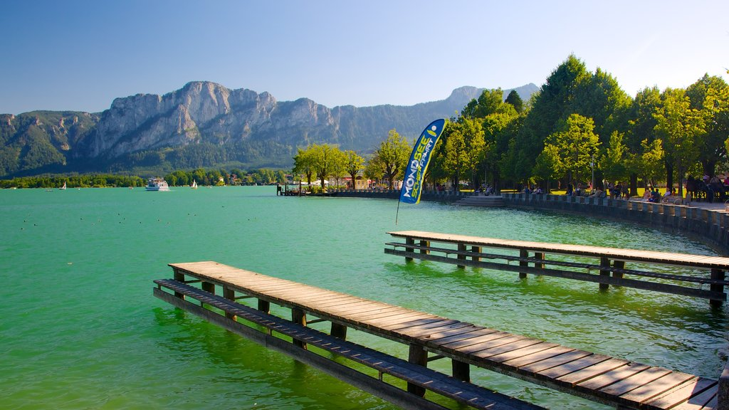 Mondsee featuring a bay or harbor, a lake or waterhole and mountains