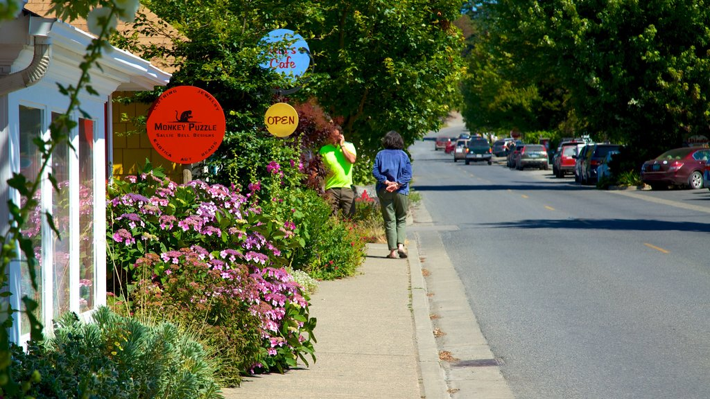 Eastsound featuring flowers, signage and a small town or village