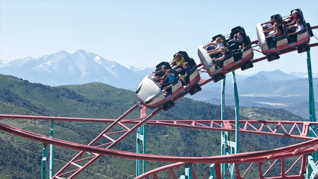 Glenwood Springs featuring landscape views and rides as well as a small group of people
