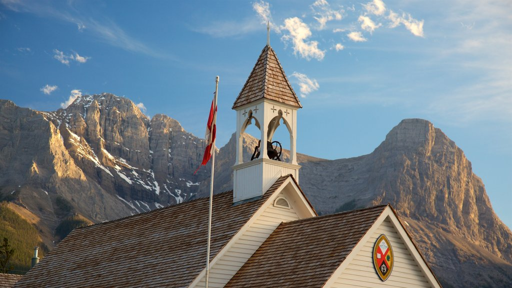 Canmore featuring heritage elements, mountains and a sunset