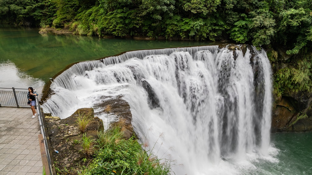Shifen Waterfall which includes a waterfall, rapids and a river or creek