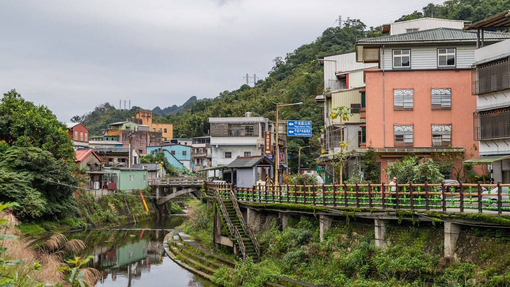 Pingxi District which includes a small town or village and a river or creek