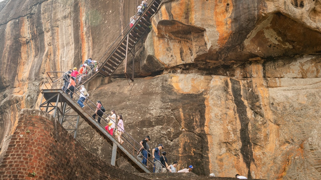 Sigiriya featuring hiking or walking and a gorge or canyon as well as a small group of people