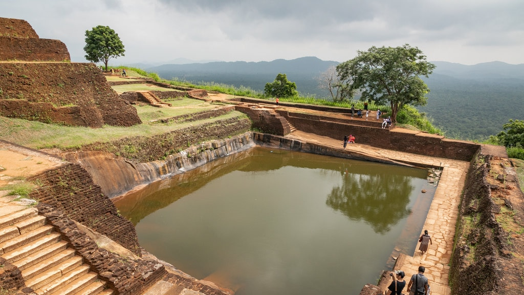 Sigiriya which includes heritage elements and a pool