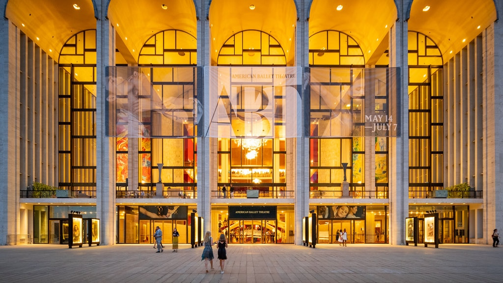 Lincoln Center which includes street scenes, signage and modern architecture