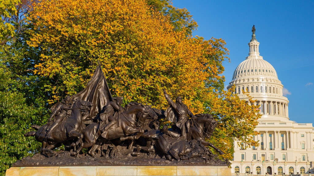 United States Capitol showing an administrative buidling, heritage architecture and autumn leaves