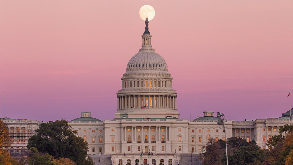 United States Capitol which includes a sunset, heritage architecture and an administrative buidling