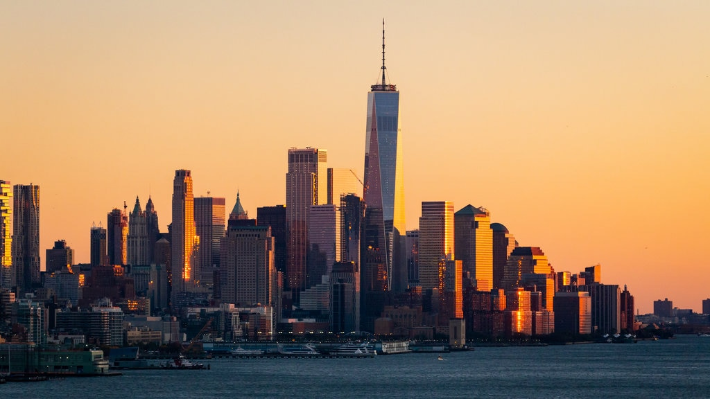 Lower Manhattan featuring a city, a sunset and a bay or harbor