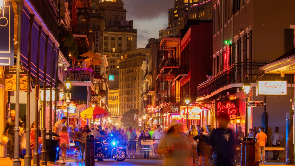 Bourbon Street showing nightlife, night scenes and a city