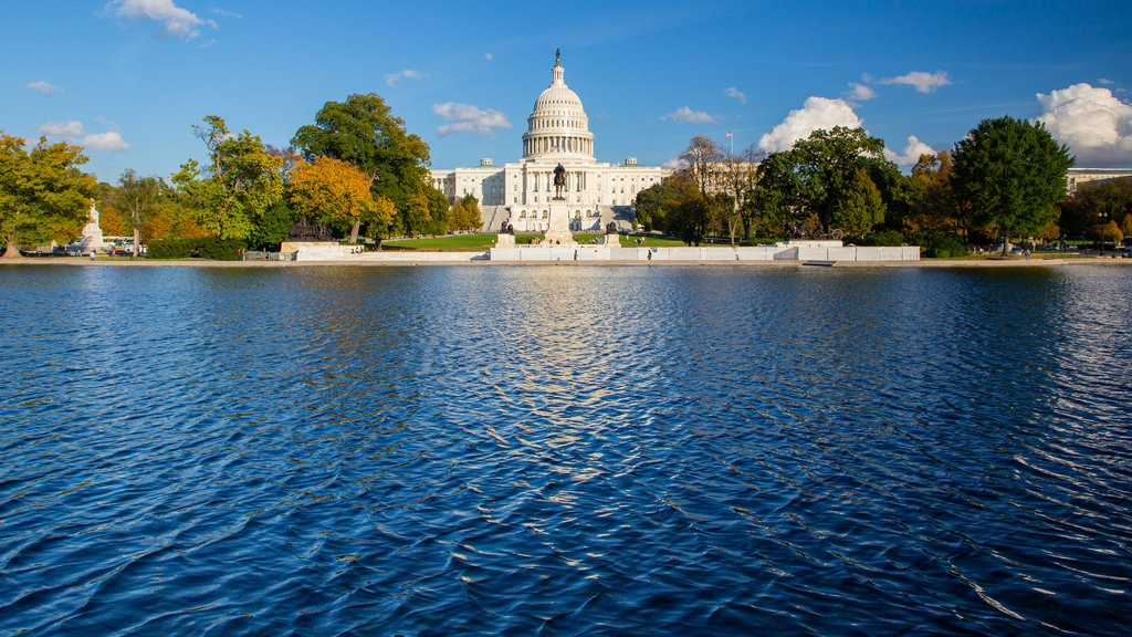 United States Capitol showing heritage architecture, an administrative buidling and a lake or waterhole