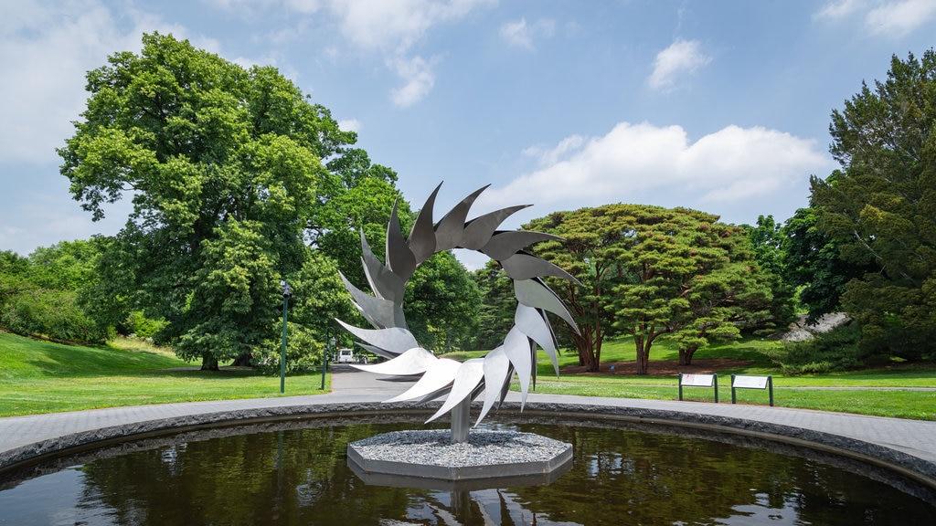 New York Botanical Gardens featuring a fountain, outdoor art and a garden