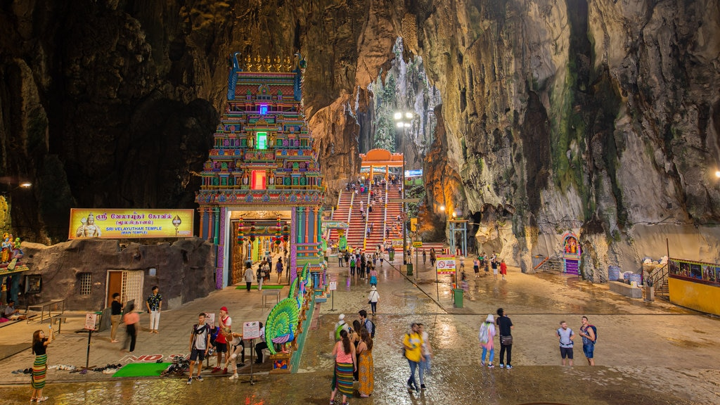 Batu Caves which includes caves and heritage elements as well as a large group of people