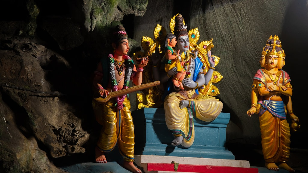 Batu Caves which includes heritage elements, interior views and religious aspects