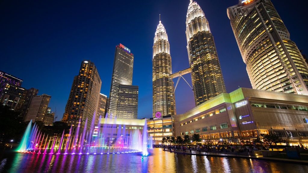 KLCC Park showing a city, night scenes and a high rise building
