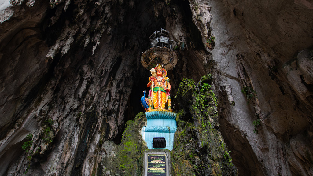 Batu Caves featuring heritage elements, a statue or sculpture and caves