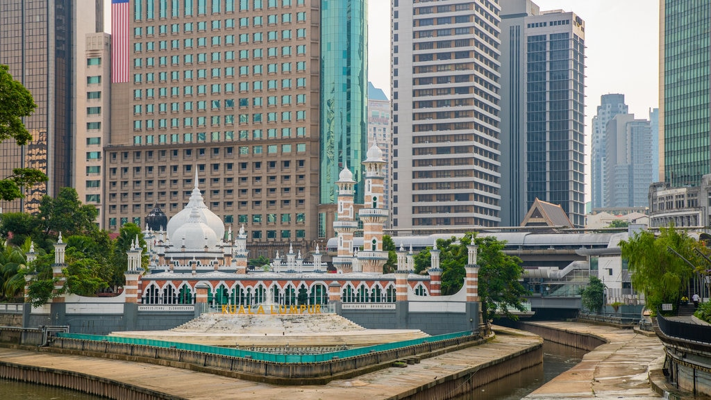 Jamek Mosque which includes a city, a river or creek and heritage elements