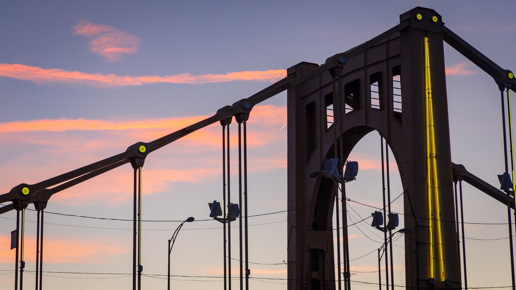 Pittsburgh featuring a bridge and a sunset