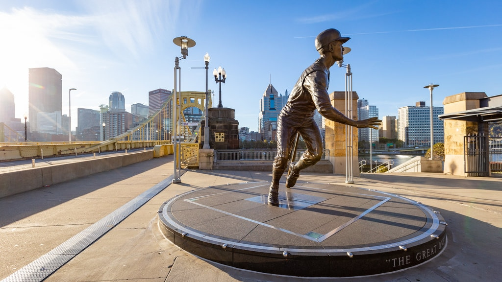 PNC Park which includes a statue or sculpture, a bridge and a sunset