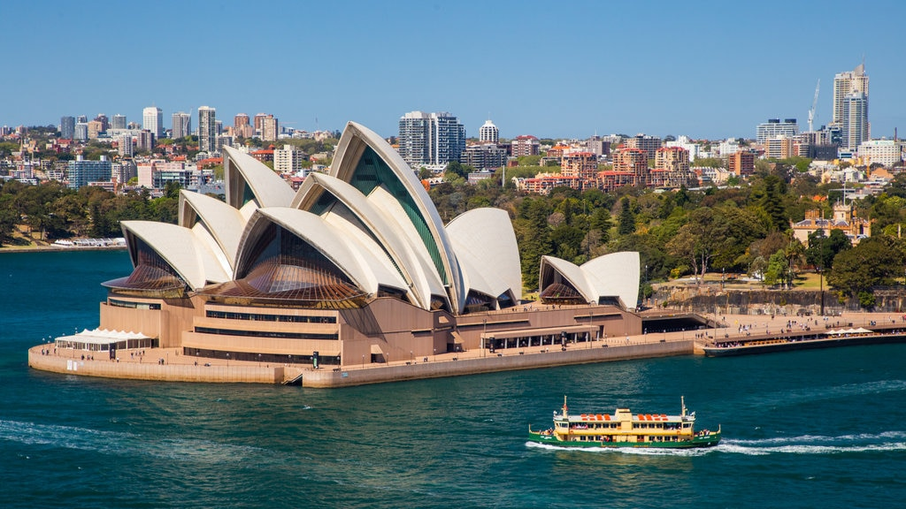 Sydney Opera House which includes boating, modern architecture and a city