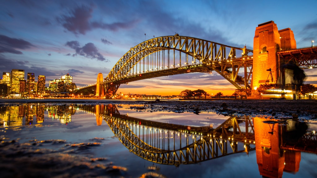 Sydney Harbour Bridge showing a bridge, night scenes and a river or creek
