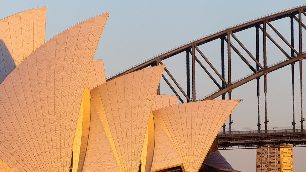 Sydney Opera House featuring a bridge and a monument