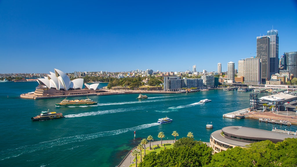Sydney which includes boating, modern architecture and a monument
