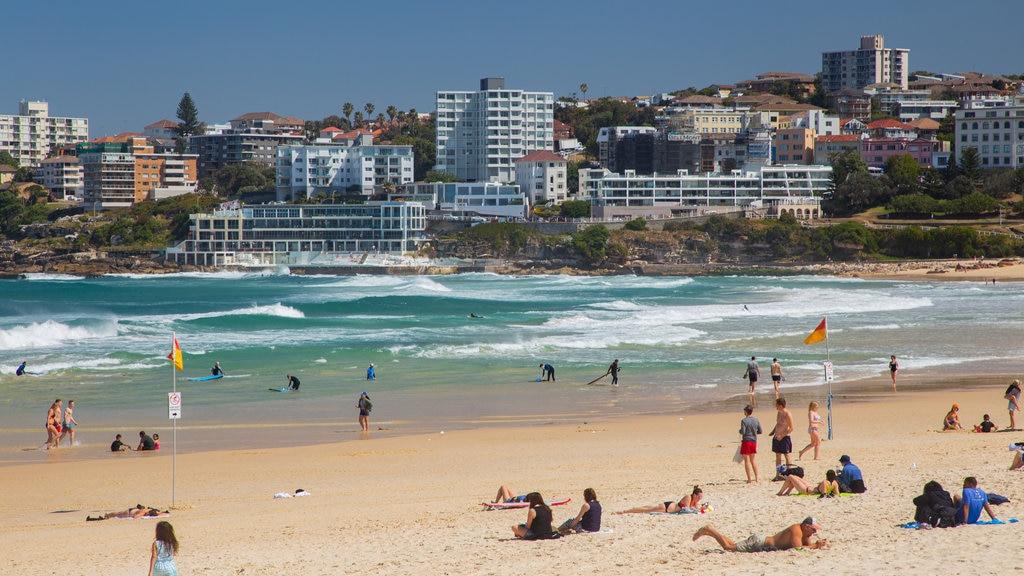 Bondi Beach showing a coastal town, general coastal views and a beach