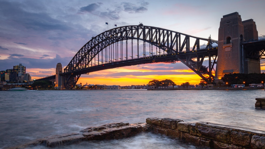 Sydney Harbour Bridge which includes a bridge, a bay or harbor and a sunset