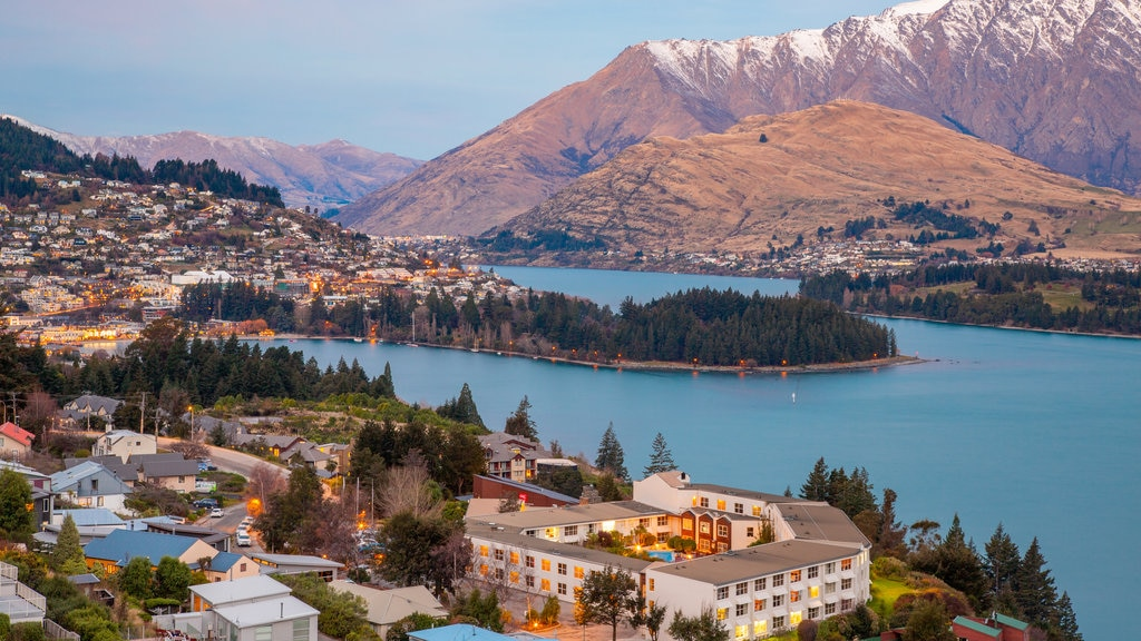 Queenstown featuring a river or creek, a small town or village and mountains