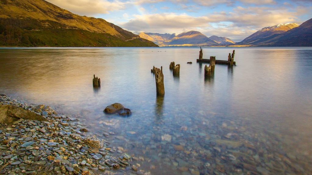Lake Wakatipu featuring a sunset and a lake or waterhole