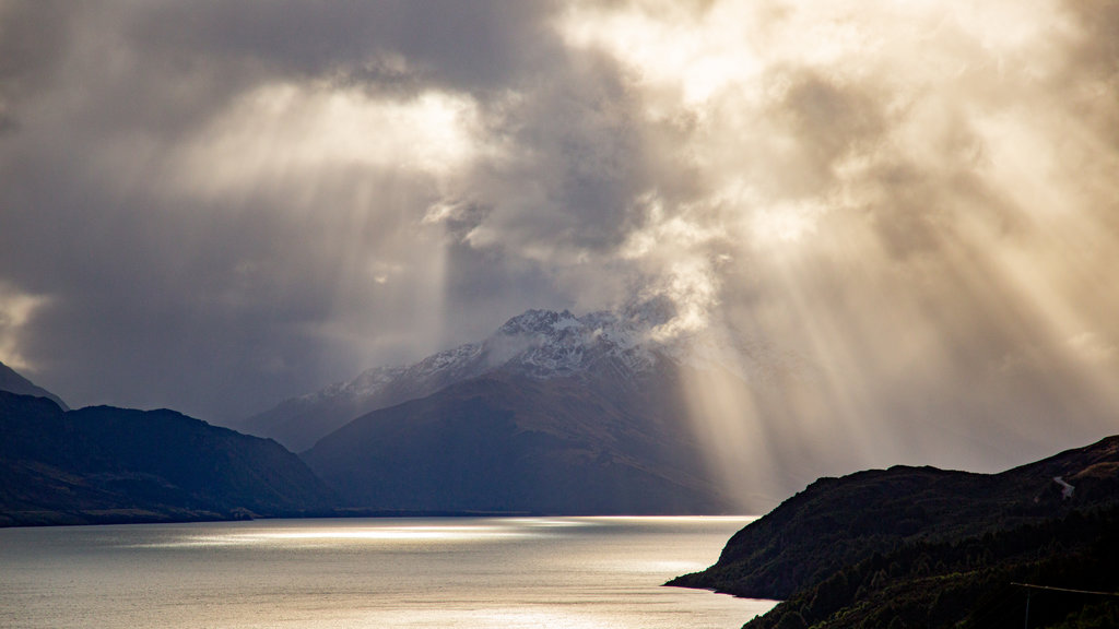 Lake Wakatipu featuring a lake or waterhole, mountains and a sunset